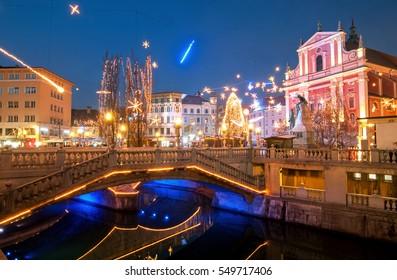 Triple bridge, illuminated for New Years celebration, Ljubljana, Slovenia