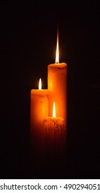 Triple candle in the dark