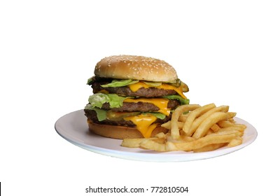 Triple cheeseburger with cheese, lettuce, onion, pickles, Sesame seed bun, french fries. Side view, isolated