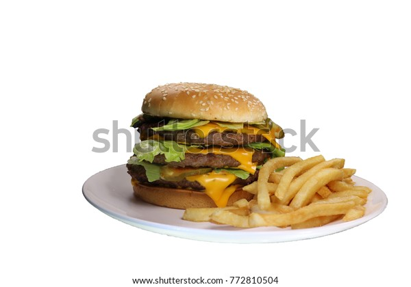 Triple cheeseburger with cheese, lettuce, onion, pickles, Sesame seed bun, french fries. Side view, isolated on white