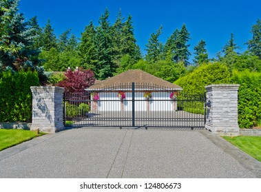Triple doors garage behind the gates. Vancouver, Canada.