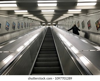 Triple escalators/Person moving up the escalator of a subway station. Stockholm, Sweden, May 22, 2018.