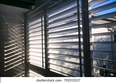 Triple outdoor white windows aluminium louver shutter at the house back yard sun room