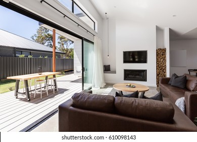 Triple sliding back glass doors from living room to outdoor deck