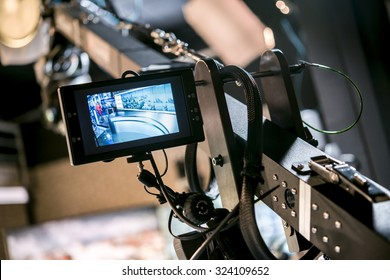 Tripod for video camera with display