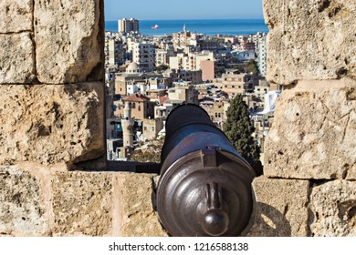 TRIPOLI, LEBANON - October 2018: Aerial view of Tripoli old city through the window of The Citadel of Raymond de Saint-Gilles, also known as Qala'at Sanjil, Lebanon. Cannon at Citadel of Tripoli.