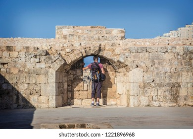 TRIPOLI, LEBANON - October 2018: Man looking through the window of old from Citadel in Tripoli downtown, Lebanon
