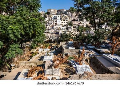TRIPOLI, LEBANON - October 2018: Muslim cemetery near the Tripoli old city citadel, Walls of The Citadel of Raymond de Saint-Gilles, also known as Qala'at Sanjil, Lebanon