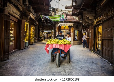 TRIPOLI, LEBANON - September 2018: Man selling fruits at Tripoli Gold Market (Souk Al-Harajb), ancient market in Tripoli, Lebanon