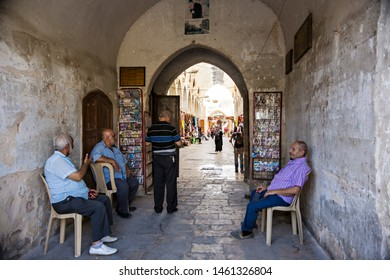 TRIPOLI, LEBANON - September 2018: Narrow market street, people on the market in Tripoli. Old Market (Souk Al-Harajb), ancient market in Tripoli, Lebanon