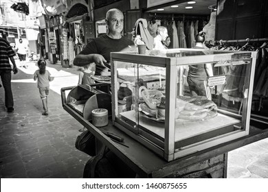 TRIPOLI, LEBANON - September 2018: Street food cart at Old Souk in Tripoli, Lebanon. People on the market in Tripoli, Lebanon