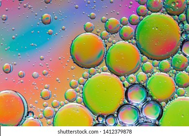 Trippy psychedelic abstract formed by oil droplets floating on water