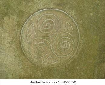 Triskelion symbol carved in stone