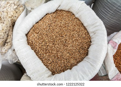 Triticale seeds in a sack bag at the market