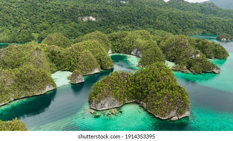 Triton Bay, Kaimana Aerial View. Lagoon With Turquoise Water And Green Tropical Trees. Wide Angle Nature: Pacific Ocean And Beautiful Landscape In West Papua, Indonesia.