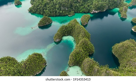 Triton Bay, Kaimana. Lagoon With Turquoise Water And Green Tropical Trees. Beautiful Landscape In  West Papua, Indonesia.