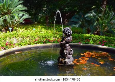 Triton Fountain in the Botanical Garden of La Concepción in Malaga
