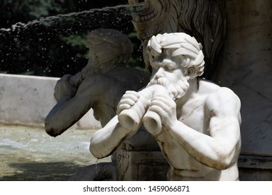 Triton, greek God. Marble sculpture. Fountain in the city park