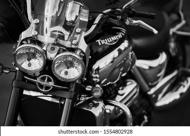 Triumph bike shot at training. A close-up of the motorcycle. Motorbike details shot in black and white. Motorcycle closeup details front view black and white chrome