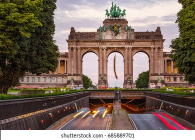 Triumphal Arch and Belliard Tunnel in Park Cinquantenaire seen in Brussels during sunset
