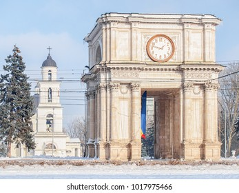 Triumphal arch in the center of Chisinau, Moldova in a sunny winter day. The Chisinau Belfry can be seen behind it