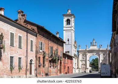 Triumphal Arch in Cherasco, Italy Cherasco,Italy,Europe - May 3, 2016 : View of the Triumphal Arch, the Sant Agostino church and its bell tower