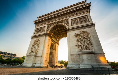 Triumphal Arch at the end of Champs-Elysees street before sunset in Paris,France