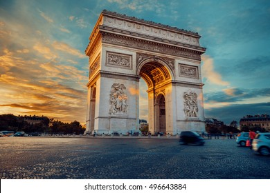 Triumphal arch. Paris. France. Place Charles de Gaulle. Famous touristic architecture landmark in summer night. Napoleon victory monument. Symbol of french glory. World historical heritage. Toned