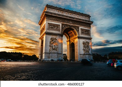 Triumphal arch. Paris. France. View of Place Charles de Gaulle. Famous touristic architecture landmark in summer night. Napoleon victory monument. Symbol of glory. World historical heritage. Toned