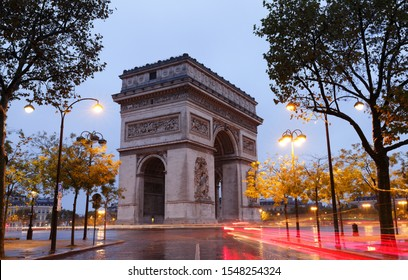 The Triumphal Arch in rainy Morning. It  is one of the most famous monuments in Paris. It honors those who fought and died for France.
