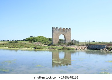 Triumphal arch of Villeneuve les Maguelone, a seaside resort in the south of Montpellier, Herault, France - Shutterstock ID 1760698166
