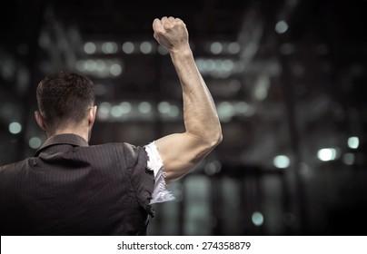 Triumphant athletic businessman