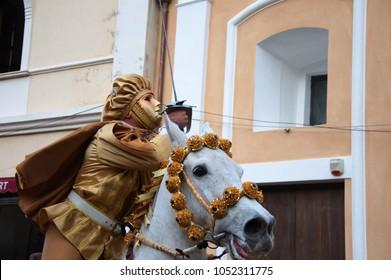 Triumphing masked horseman with star in Sartiglia carnival manifestation, Oristano, Sardinia, Italy