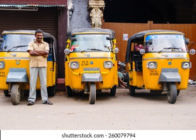 "Trivandrum, India - December 11, 2011: Indian auto rickshaws in street. Auto rickshaws (called ""autos"" or ""tuk tuk"") provide cheap transportation in indian cities instead of taxies for short distances"