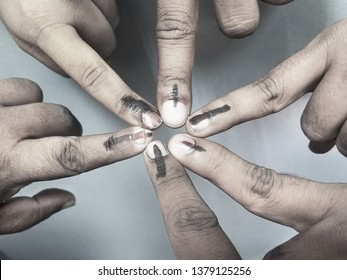 TRIVANDRUM, KERALA, INDIA, APRIL 24, 2019: Top view of forefingers of voters who voted in the 17th Indian Parliamentary (Lok Sabha) elections showing indelible electoral ink. Long live democracy.