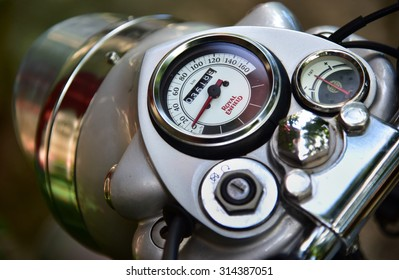 TRIVANDRUM, KERALA, INDIA, AUGUST 29, 2015: Royal Enfield (Bullet) bike. Close up showing the headlight, speedometer and the fuel gauge, top down view.