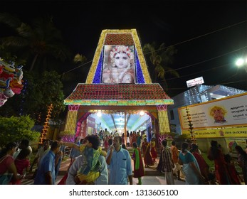 TRIVANDRUM, KERALA, INDIA, FEBRUARY 13, 2019: Devotees at the main entrance of Attukal Bhagavathy temple, during the annual pongala festival, at night.