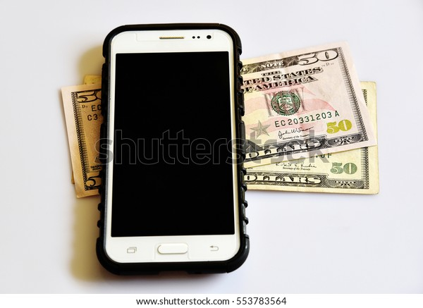 TRIVANDRUM, KERALA, INDIA, JANUARY 10, 2017:  Top down view of a mobile phone on two fifty dollar bills on white background. Mobile banking concept. Cashless transaction. Net banking.
