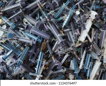 TRIVANDRUM, KERALA, INDIA, JULY 01, 2018: Hospital waste. Heap of used, disposable syringes with destroyed needles, waiting to be incinerated.