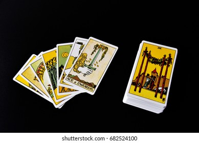 TRIVANDRUM, KERALA, INDIA, JULY 22, 2017: A deck of Tarot cards on dark background, three cards spread with the Ace of swords on the top.