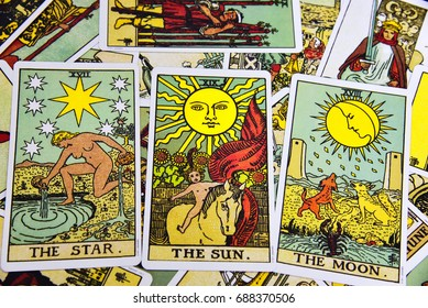 TRIVANDRUM, KERALA, INDIA, JULY 31, 2017: Tarot cards the Sun, the moon and the Star spread evenly on a table.