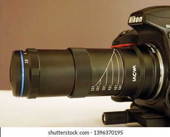 TRIVANDRUM, KERALA, INDIA, MAY 07 2019: Fully extended (5X) Laowa 25mm f/2.8 2.5-5X Ultra Macro lens on a Nikon D750 camera mounted on a  Manfrotto 454 Sliding Plate. Side view.