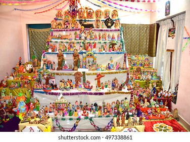 TRIVANDRUM, KERALA, INDIA, OCTOBER 06, 2016: Ritualistic display of Bommai Kolu (dolls and figurines) at a Hindu household, as part of the Navaratri festival.