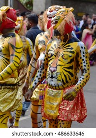 TRIVANDRUM, KERALA, INDIA, SEPTEMBER 18, 2016: Onam celebrations in the city conclude with a procession of cultural extravaganza. Pulikali (people paint their body as tigers and leopards, and dance).