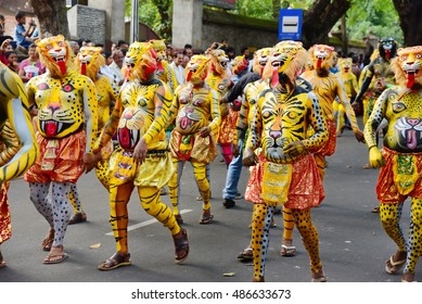 TRIVANDRUM, KERALA, INDIA, SEPTEMBER 18, 2016: Onam celebrations in the city conclude with a procession of cultural extravaganza. Pulikali (people pain their body as tigers and leopards).