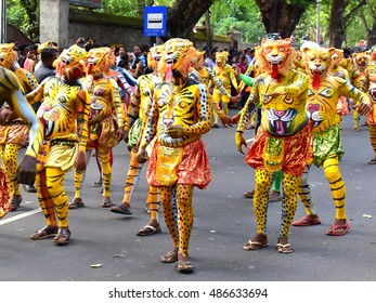 TRIVANDRUM, KERALA, INDIA, SEPTEMBER 18, 2016: Onam celebrations in the city conclude with a procession of cultural extravaganza. Pulikali (people paint their body as tigers and leopards).