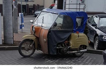 triwheel vintage vehicle on the pracing - Shutterstock ID 1964662240