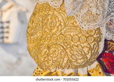 Trnava, Slovakia - 19.8.2017: Detail of an antique national costume sleeve from Trnava region, a presentation as part of Trnavska brana folkloric festival
