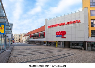 """TRNAVA, SLOVAKIA - JANUARY 21, 2019: """"Obchodny Dom Jednota"""" in Trnava, situated on Square of the Holy Trinity. Department house COOP Jednota in Trnava. Department store on main square in Trnava."""