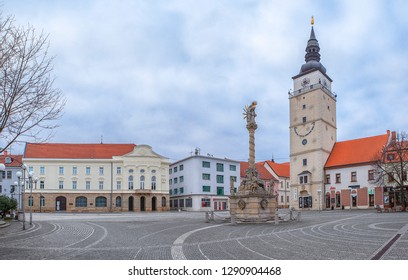 TRNAVA, SLOVAKIA - JANUARY 21, 2019: Panoramatic view of main square in Trnava. Central European City. Photo of Square of the Holy Trinity with City Tower, Statue of Holy Trinity and City Theatre.